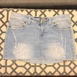 Distressed denim mini skirt.